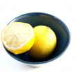 Lemon on a plate — Stock Photo