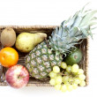 A big variety of exotic fruits in a basket — Stock Photo