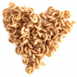 Macaroni forming a heart over white background. Concept of healthy food. — Stock Photo