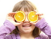 Girl with orange slices — Stock Photo