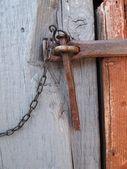 Locked old wooden door — Stock Photo