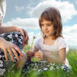 Mom and daughter on a meadow — Stock Photo #10595649