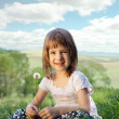 Stock Photo: Little girl on a meadow