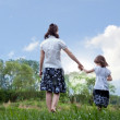 Mother and daughter - holding hands — Stock Photo