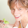 Vegetarian - woman eating salad - Stock Photo