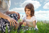 Mom and daughter on a meadow — Stock Photo