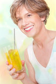 Attractive happy woman with glass of juice — Stock Photo