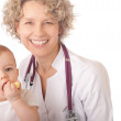 Smiling doctor and baby patient. — Stock Photo