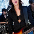 Female guitarist playing at a concert — Stock Photo #8880082