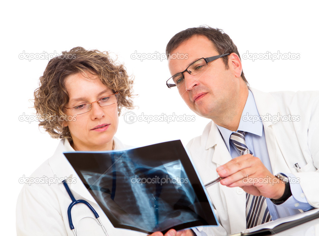 Two doctors looking an x-ray image — Stock Photo #8880124