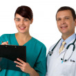 Portrait of doctor with young practitioner — Stock Photo