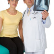 Doctor and patient looking an x-ray image — Stock Photo
