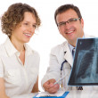 Stock Photo: Doctor and patient looking an x-ray image
