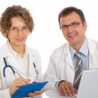 Two doctors write medical reports — Stock Photo