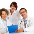 Portrait three doctors write medical reports — Stock Photo