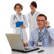 Portrait of a male doctor with two of his co-workers — Stock Photo