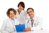 Portrait three doctors write medical reports — Stock Photo