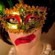 Beautiful  woman in a mysterious mask — Stock Photo