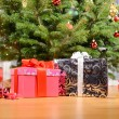 Stock Photo: Gifts under the Christmas tree