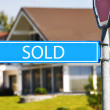 SOLD street sign against house — Stock Photo #8297211
