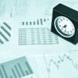 Clock on the market reports — Stock Photo