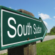 SOUTH SUDAN signpost along a rural road — Stock Photo