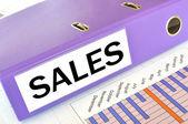 SALES folder on a market report — Stock Photo