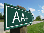 AA-plus (credit rating) signpost along a rural road — Stock Photo