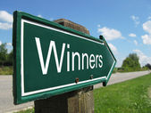 Winners signpost along a rural road — Stock Photo