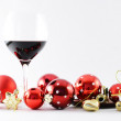 Wineglass and Christmas decoration — Stock Photo