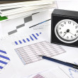 Royalty-Free Stock Photo: Clock, files and pen on a market report