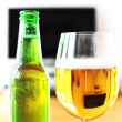 Glass of beer against TV-set — Stock Photo #8317922