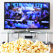 Pop-corn and TV-set — Stock Photo