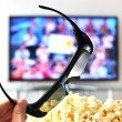 Stock Photo: 3D glasses against TV-set