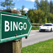 Stock Photo: BINGO sign against sportive car on the rural road