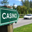 CASINO sign against sportive car on the rural road — Stock Photo