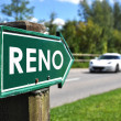 Постер, плакат: RENO sign against sportive car on the rural road