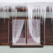 Icicles against a window — Stock Photo