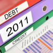 Stock Photo: Debt, 2011, Credit folders on afinancial report