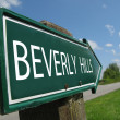 Stock Photo: BEVERLY HILLS signpost along rural road
