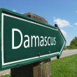 Damascus signpost along a rural road — Stock Photo