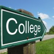College signpost along rural road — Stock Photo #8318374