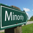 Minority signpost along a rural road - Stock Photo