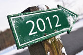 2012 road sign covered with snow — Stock Photo