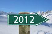 2012 arrow against mountain ridge — Stock Photo