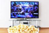 Pop-corn and TV-set — Stock Photo
