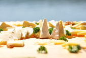 Cheese and parsley on the plate — Stock Photo