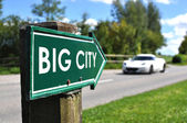 BIG CITY road sign — Stock Photo