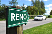RENO sign against sportive car on the rural road — Stock Photo