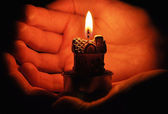 Candle in the hand — Stock Photo